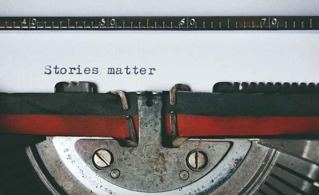 "Picture of a typewriter with the words ""stories matter"" on the paper."